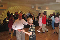 Queen Bee´s Art & Cultural Center swing ballroom dancing on San Diego's hardwood dance floor.